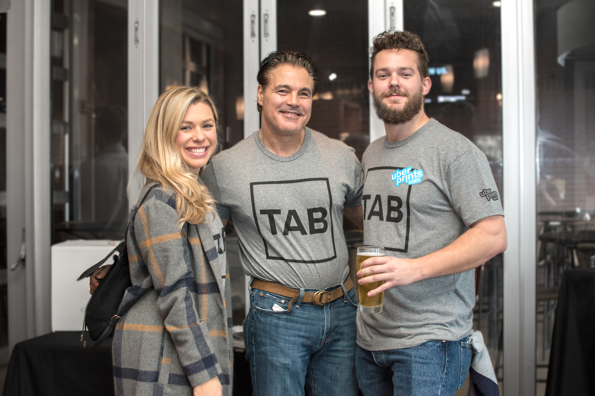 Event attendees wearing their custom printing TAB t-shirts.