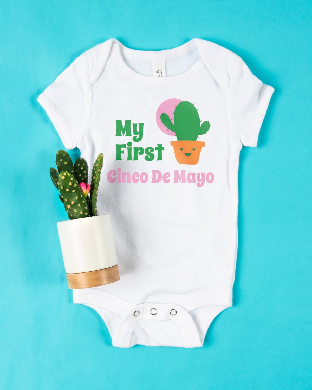 A custom Cinco de Mayo t-shirt design on an infant onesie.