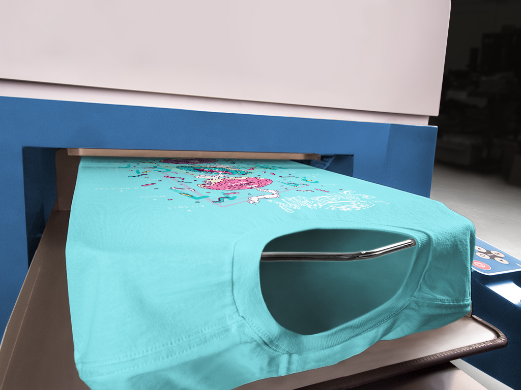 A close up view of a t-shirt being digitally printed on a direct-to-garment printer.