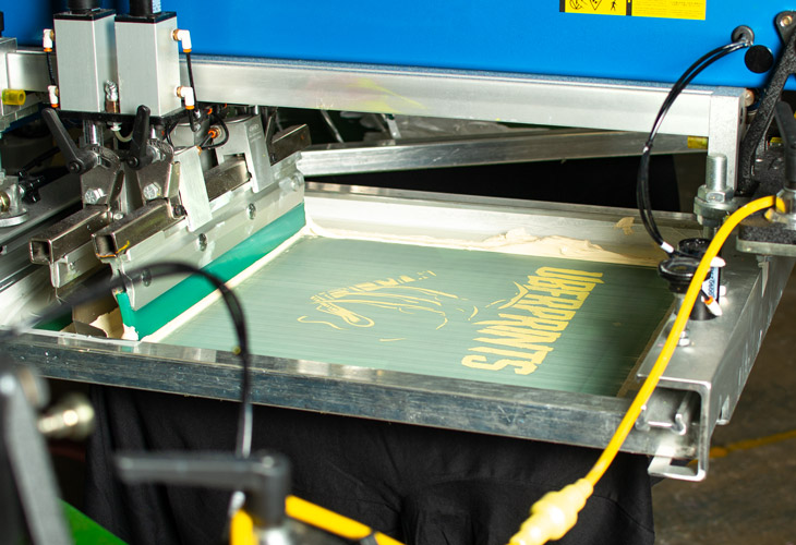 Printing the cream color for the Halloween t-shirt design.