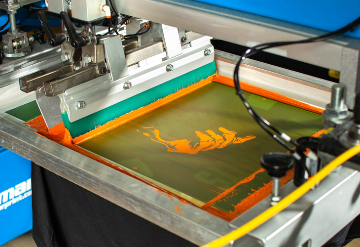Printing the brown color for the Halloween t-shirt design.