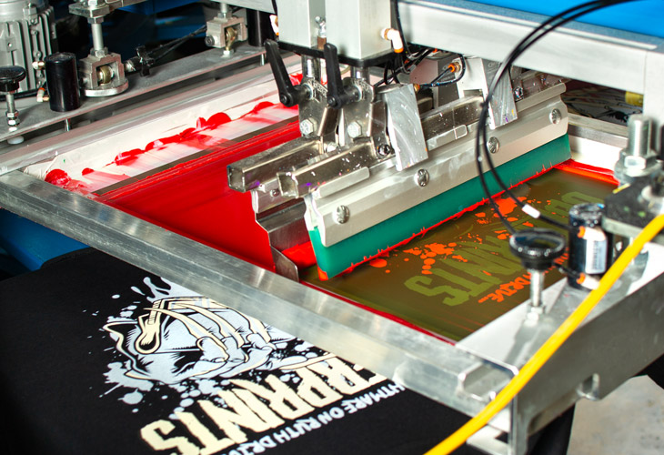 Printing the red color for the Halloween t-shirt design.