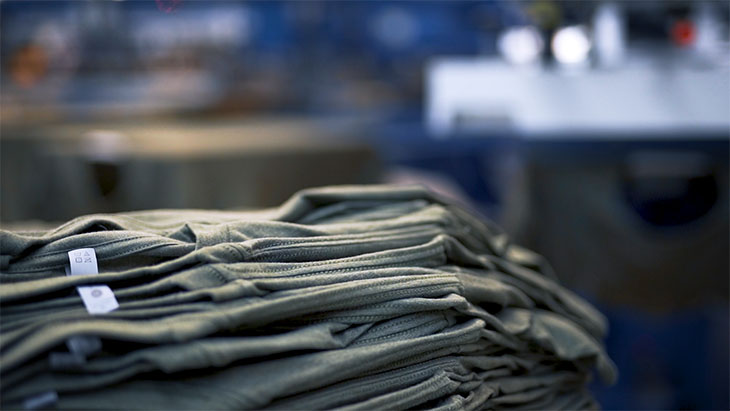 A stack of blank t-shirts prepared to be screen printed.