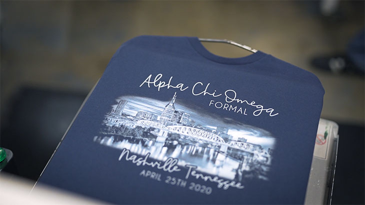 A photographic image being digitally printed onto a custom t-shirt.